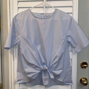 Pastel blue blouse with tie